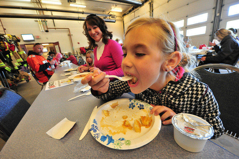 A young pancake enthusiast enjoys the free breakfast at the Estes Valley Volunteer Fire District open house on Saturday. Children also had the chance to explor equipment and lear fire safety.