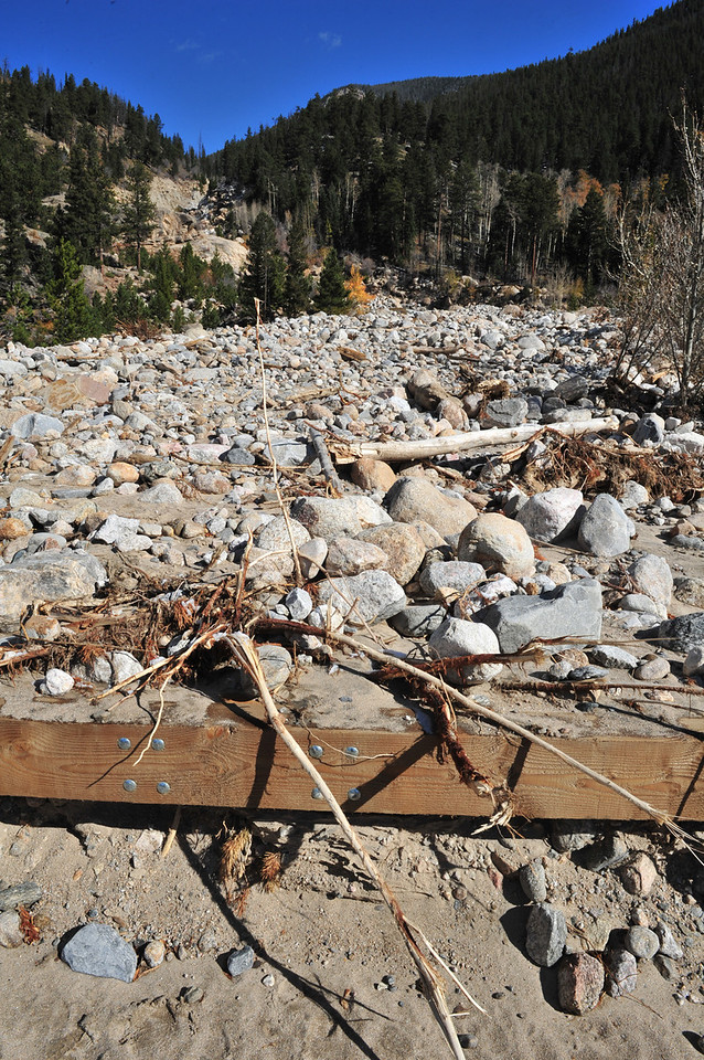 Flood debris chokes the stream bed at the automobile bridge at the Alluvial Fan on Wednesday. Rocks and sand filled the stream bed to the point of spilling over the top of the bridge and moving the Roaring River's chanel 300 feet west.