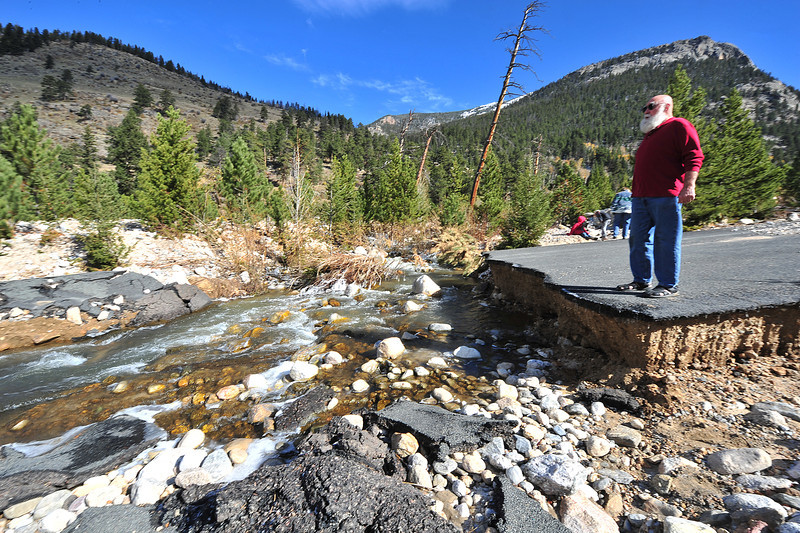 John Shager of Longmont is stunned by the destruction at the Alluvial Fan on Wednesday. Debris carried by the Roaring River damed up the automobile bridge at the site, diverting the river about 300 feet west, where the river tore away the road.
