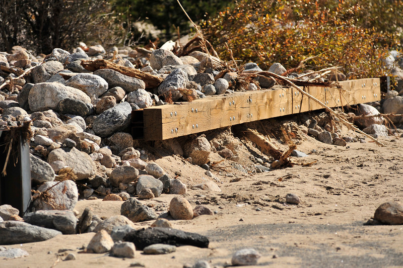 The driving bridge at the Alluvial Fan seems to hold back rocks and debris on Wednesday. Flood waters dammed up the Roaring River at the bridge, rerouting the stream about 300 feet west.