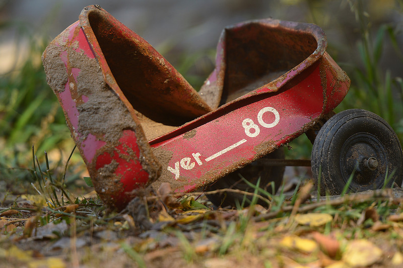 A crumpled Radio Flyer wagon sits along the road to Glen Haven on Wednesday. The town was all but wiped from the map by the historic September flood.