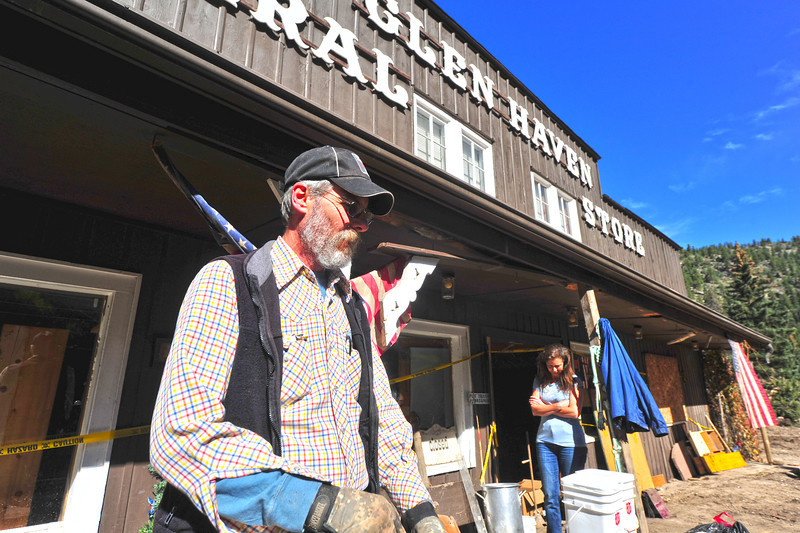 Steve and Becky Childs work to clean out the Glen Haven General Store on Wednesday. Their store was one of only four buildings still standing after the floodwaters coursed through the little town northeast of Estes Park, now the couple waits to hear if they can rebuild.