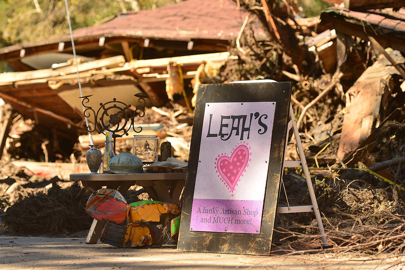 Leah DiCapio's sign and a few salvaged pieces are all that remains of her Glen Haven store. Leah's and all of the buildings between the shop and the town hall were washed downstream, resting against the Glen Haven General Store.