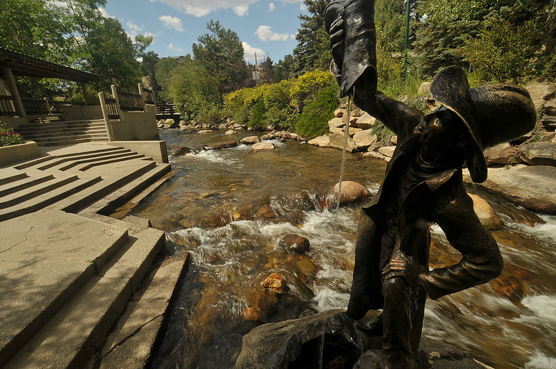 Photo by Walt Hester<br /> A cowboy statue dumps water from his boot in Tregent Park on Tuesday.