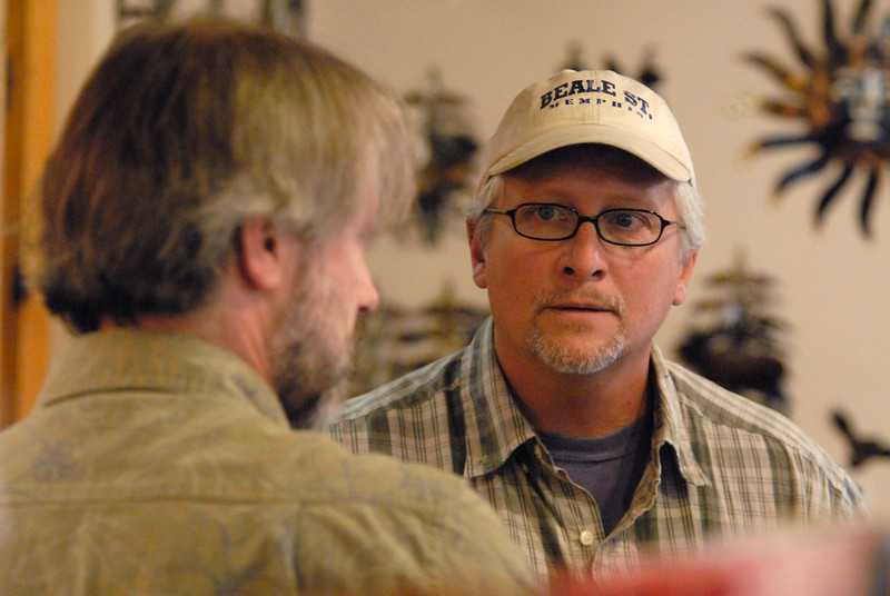 Photo by Walt Hester<br /> Plein Air painter                    talks to local gallery owner              on Wednesday.