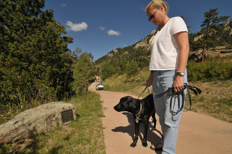 Photo by Walt Hester<br /> Karen Muchmore enjoys the newly-opened section of the Fall River Trail with her dog, Jaxson, on Wednesday.