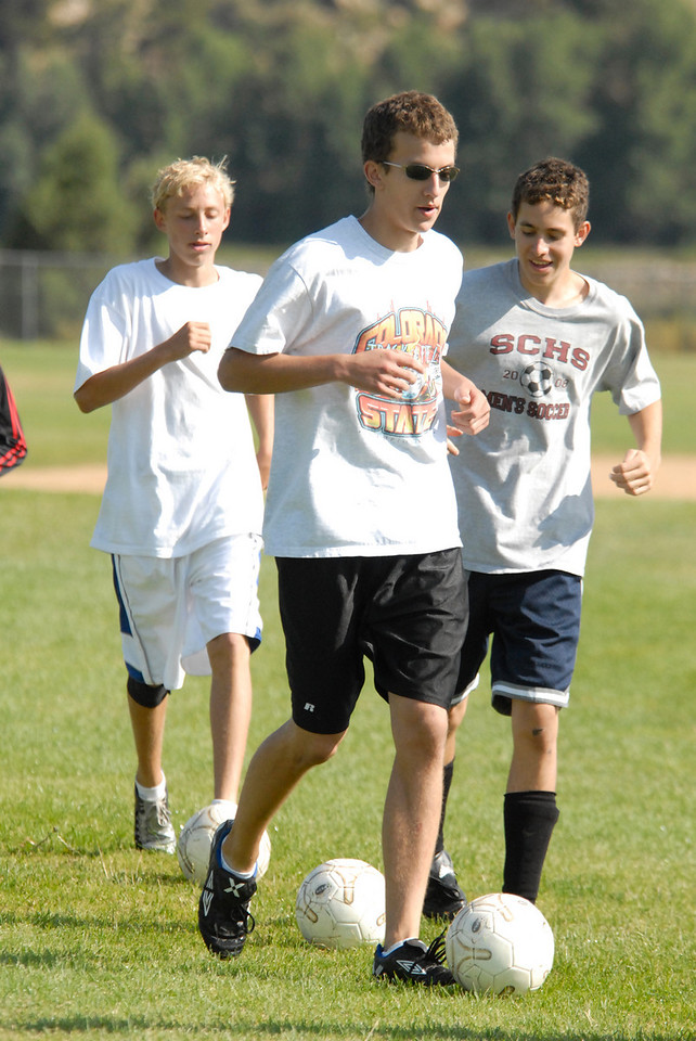 Photo by Walt Hester<br /> Bobcats' senior footballer Zak Hall leads the team around the pitch during morning practice on Tuesday.