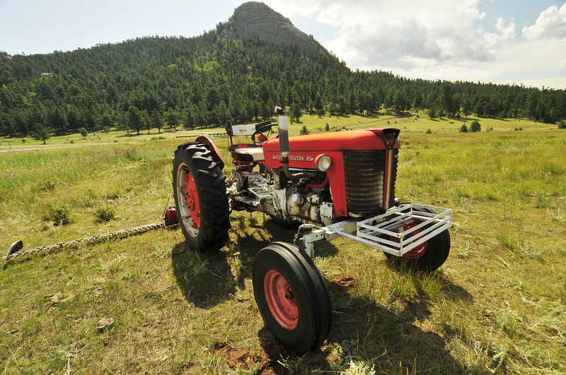 Photo by Walt Hester<br /> An antique tractor decorates a pasture below Eagle Rock along Dry Gulch Road on Tuesday.