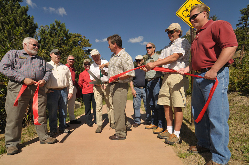 Photo by Walt Hester<br /> Estes Park mayor Bill Pinkham and public works director Scot Zurn cut the ribbon to open the new section of the Fall River Trail east of downtown on Wednesday. The town hopes to extend the trail all the way to the Fall River gate of Rocky Mountain National Park.