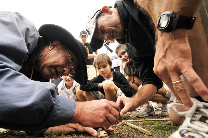 Photo by Walt Hester<br /> Mountain men demonstrate the early ways of life, such as starting a fire without matches, in the Rockies at the annual Heritage Festival.
