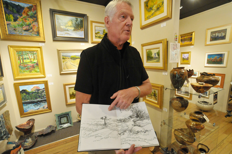Photo by Walt Hester<br /> Plein Air painter                 talks about his sketches on Wednesday.