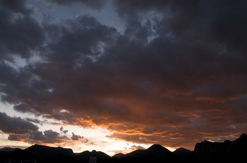 Photo by Walt Hester<br /> Sunset stains clouds over Estes Park on Tuesday