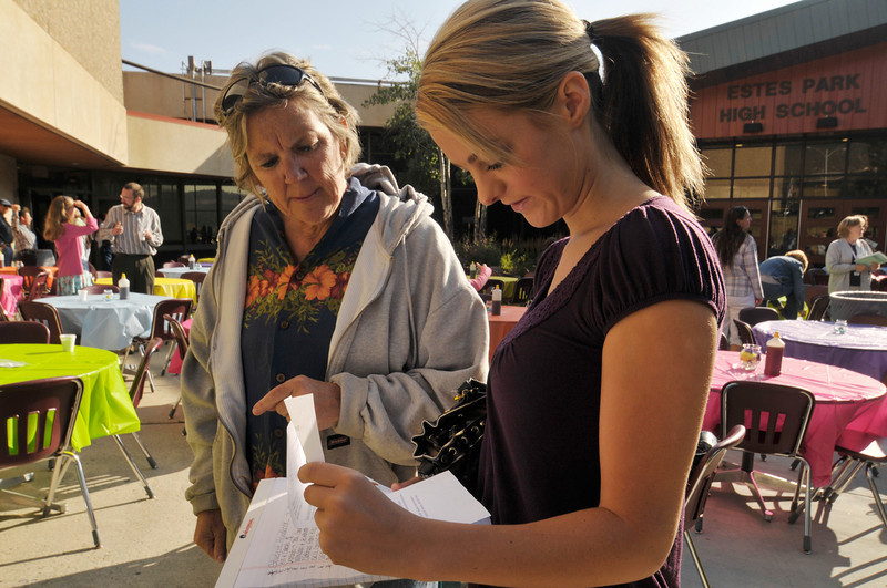 Photo by Walt Hester<br /> Estes Park Middle School teacher Martha Teirney helps new student teach Jenny Dinsmoor at the school district's kickoff breakfast on Tuesday. Dinsmoor will be teaching at the high school this fall.