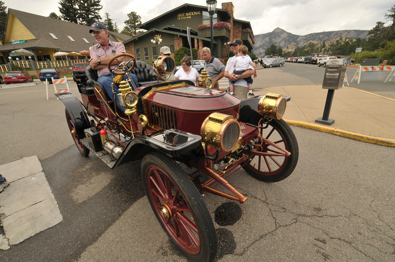 Photo by Walt Hester<br /> A Stanley Steamer chugs past Bond Park during last year's Heritage Festival. Visitors enjoy rides in the old steam car during the festival.