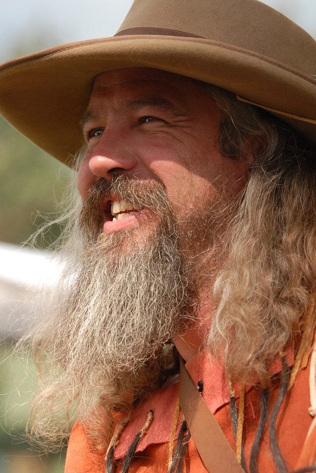 Photo by Walt Hester<br /> A mountain man enjoys last year's Heritage Festival in Bond Park. The men and women who keep the ways of the old hunters and trappers travel to Estes Park from Kansas, Wyoming, New mexico and all over Colorado.
