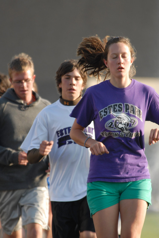 Photo by Walt Hester<br /> Chelsea Weitzel, 16, leads Ian Mclain, 14, and Jeff Switzer, 13, during a mile-long time trial during practice on Tuesday morning.