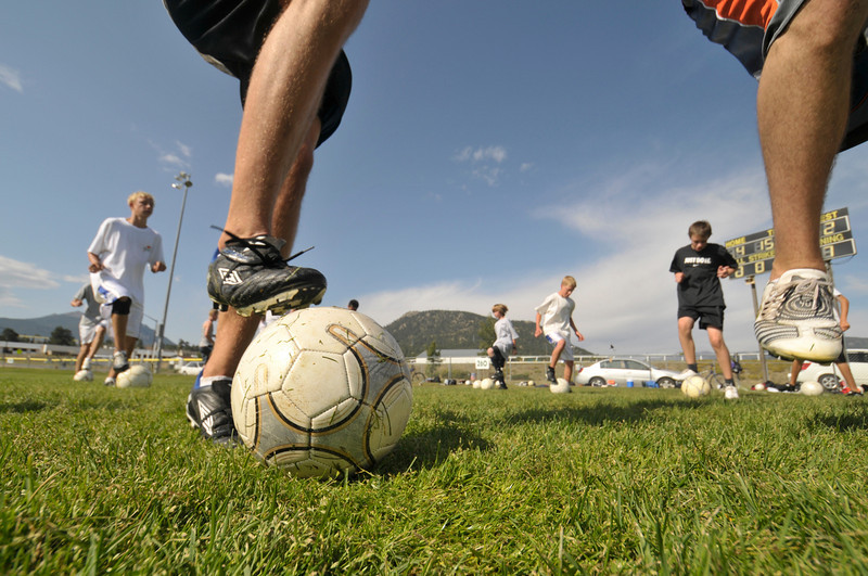 Photo by Walt Hester<br /> Estes Park High School boys soccer practice balance, foot speed and ball handling during drills during Tuesday's practice at the Stanley Park ball fields. Bobcats' soccer home opener is Monday, Sept. 14.