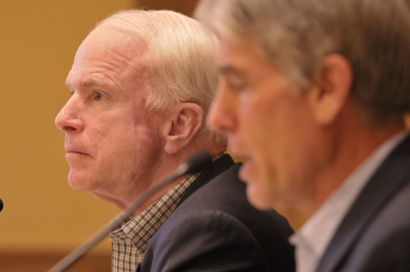 Photo by Walt Hester<br /> Senator John McCain, R, of Arizona waits his turn to speak as Senator Mark Udall, D, of Colorado opens the hearing on climate change at the Estes Park Town Hall on Monday.