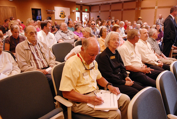 Photo by Walt Hester<br /> Mayor Bill Pinkham and several town trustees sat in the packed town hall for the hearing with Senators Mark Udall, D, of Colorado, and John McCain, R, of Arizona on Monday. The hearing was to discuss climate change and how it effects the National Park system in general and the bark beetle infestation specifically.