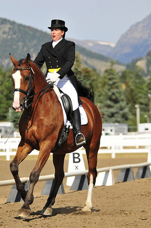 Photo by Walt Hester<br /> K.C. Parkins-Kyle of Castle Rock, Colo. rides Olaf during the dressage competition at the Stanley Fair Grounds on Sunday. Riders in dressage try to guide their horses with as little detectable effort as possible, making the rider and horse seem to be moving as one.