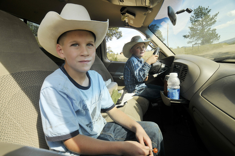 Photo by Walt Hester<br /> Little guys offer big help at MacGregor Ranch on Thursday. Children traditionally play a vital role in ranching families, even driving the ranch truck when needed.