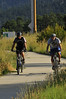 Photo by Walt Hester<br /> A pair of cyclists glide along the Fish Creek Trail on Sunday.