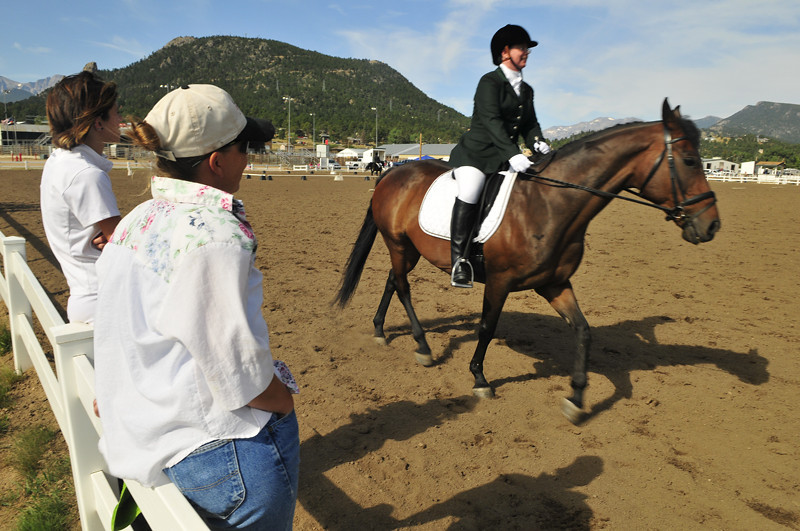 """Photo by Walt Hester<br /> Lora Mihelic of Denver practices atop """"Exception to the Rule"""" for Sunday's Training Level Adult Amature division of the dressage competition at the Stanley Fair Grounds on Sunday. The Olympic sport requires the rider to be in tune with her mount."""
