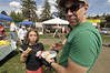 Photo by Walt Hester<br /> While not historic, festival-goers Kendall Sack, 9, of Denver and Jason Sack of Washington D.C. enjoy a funnel cake on Sunday. The sugar-covered confection is a staple of festivals from coast to coast.