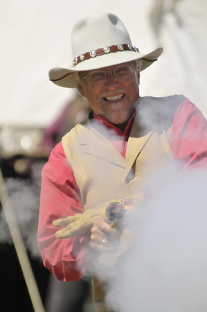 Photo by Walt Hester<br /> Cajun Joe of the Sand Creek Raiders demonstrates his skill with a six-gun at the Heritage Festival on Sunday. The members of the Single Action Shooting Society explained that the Hollywood gunfights were extremely rare and that more horses were killed then people in the old West shootouts.
