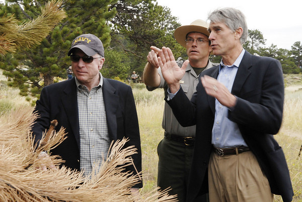 Photo by Walt Hester<br /> Senators John McCain of Arizona, laft, and Mark Udall, right, of Colorado, listen to Rocky Mountain National Park Chief of Resource Management, Ben Bobowski, explain the plight of the lodge pole pine of the park. The senators toured both Rocky and Arizona's Grand Canyon National Park to see first-hand effects of climate change.