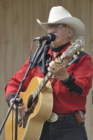 Photo by Walt Hester<br /> Local cowboy entertainer Vic Anderson entertained the crowd on Sunday with renditions of old cowboy songs.
