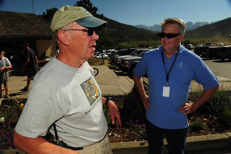 Walt Hester | Trail Gazette<br /> Mayor Bill Pinkham, left, and new town administrator Frank Lancaster watch the Woodland Park Fire from the National Park Village on Saturday. Both officials have homes in the High Drive neighborhood.
