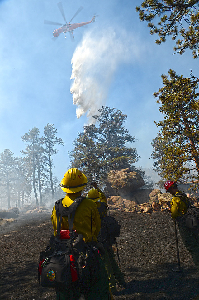 Walt Hester   Trail Gazette<br /> Firefighters from Black Hills National Forest take a moment to watch a type-one helicopter drop thousands of gallons of water on Saturday's Woodland Heights Fire. The tragic High Park Fire made getting firefighters and air support to Estes Park much easier than it might otherwise have been.