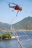 A type 1 helicopter moves into position to refill it's 3,000 gallon water tank from Lake Estes to help fight the Woodand Heights Fire west of downtown Estes Park Saturday, June 23.