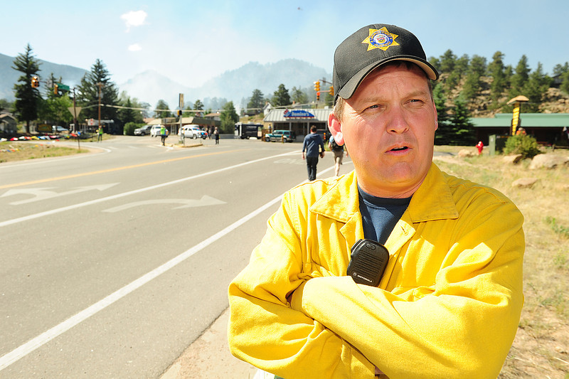 Walt Hester | Trail Gazette<br /> Larimer County Sherif Justin Smith addresses the media on Saturday. The sherif came off the High Park Fire to help on the Woodland Heights fire.