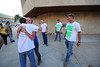 "Walt Hester | Trail Gazette<br /> The crew from the Stanley Fairgrounds distributes ""Free Hugs"" at the Red Cross Evacuation Shelter at the high school on Saturday. ""I've been evacuated from my home twice and I think people just need this,"" said Nate Dewitt, center, white t-shirt."