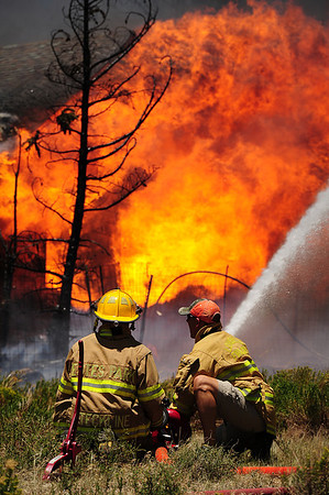Walt Hester | Trail Gazette<br /> Firefighters Donny Steckline of Estes Park and James Bage of Louisville try to slow the advance of the Woodland Heights Fire early Saturday afternoon. Firefighters from as far away as Black Hills National Forest jumped in to help.