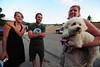 "Walt Hester | Trail Gazette<br /> Erica Goad and Paul Larson smile after returning ""Maggie"" to owner Ellen Allen at the Estes Park High School on Saturday. Larson and Goad are neighbors of Allen's and grabbed her dog when the Woodland Fire broke out on Saturday afternoon."