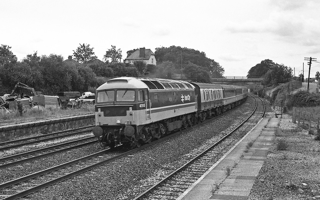 47515, 10.30 Penzance-Glasgow, taken from the vandalised disused signalbox at the former Tiverton Junction Station at Willand, near Tiverton, 18-7-87.