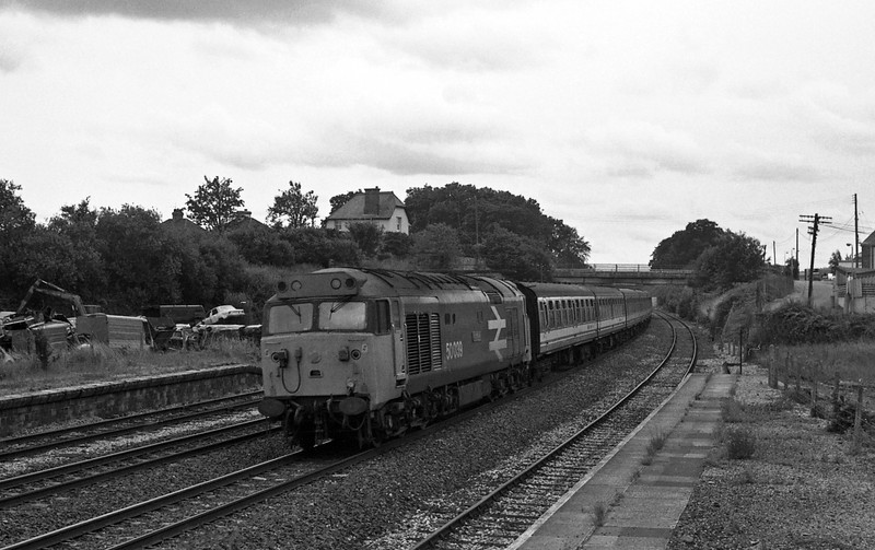 50039, 14.20 Paignton-Cardiff Central, taken from the vandalised disused signalbox at the former Tiverton Junction Station at Willand, near Tiverton, 18-7-87.