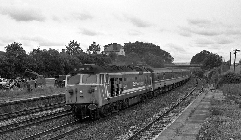 50017, 11.32 Penzance-Liverpool Lime Street, taken from the vandalised disused signalbox at the former Tiverton Junction Station at Willand, near Tiverton, 18-7-87.