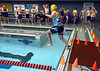Contestants, including Heather Moore, Harleysvillle, step into the high school pool at 15-second intervals for the swimming portion of the Upper Dublin Triathlon Sunday, May 17, 2015.Photo by Bob Raines