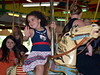Violet Wilkerson, 4yrs old waved to her dad as she passed by while riding Perkasie Carousel on Memorial Day, May 25, 2015. Photo by Debby High