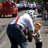 Aidan Nolan runs into the street to hug Sparky the Fire Dog during the Wyndmoor Memorial Day Parade May 25, 2015. Photo by Bob Raines
