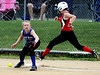 Harleysville's Melissa Peters makes it to first base on an error by Deep Run's Lauren Howe.  Photo by  Bob Raines
