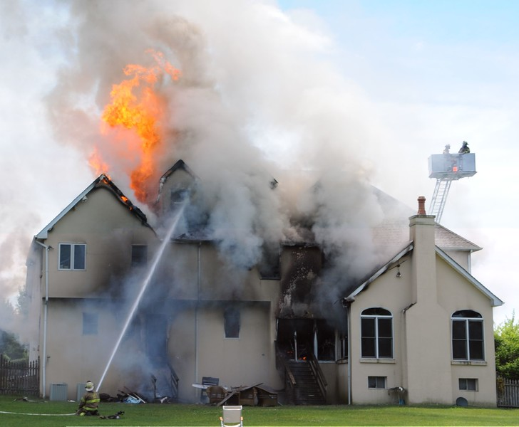 "Fire caused extensive damage to a two-story home at 105 Burgundy Circle in Whitpain Township Saturday, June 13. There were no injuries, though Whitpain Fire Marshal Dave Camarda said the house was ""probably a total loss.""  Photo courtesy of William Foy Jr."