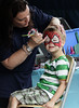 Patrick Howland has his face painted by Karen Dinan to look like Spiderman at Horsham Day June 6, 2015.<br /> Photo by Bob Raines