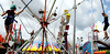 Three girls bounce around at the end of bungee cords  at the June Fete Village Fair Saturday, June 6, 2015.<br /> Bob Raines--Montgomery Media