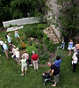 Suzanne Smith-Oscilowski, an environmental educator with the Wissahickon Valley Watershed, leads one of the groups taking a tour of Ambler's Rain Gardens Sunday, June 7, 2015. Rainwater runoff is directed into shallow basins filled with native plants where it able to percolate into the ground.  photo by Bob Raines