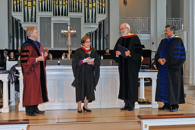 Bishop Claire Burkat - center left - introducing speaker Mark Hanson - center right